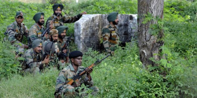 JAMMU, INDIA - SEPTEMBER 26: Army soldiers take position during a terrorist attack on an army camp in...