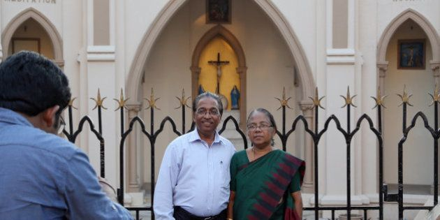 A christian couple poses for a photograph outside a church in Mumbai, India, Tuesday, March 17, 2015....