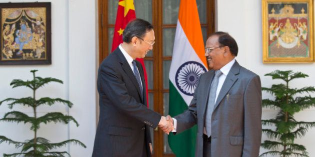 India's National Security Adviser Ajit Kumar Doval, right, and Chinese State Councilor Yang Jiechi...