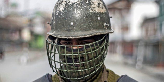 SRINAGAR, KASHMIR - FEBRUARY 11: An Indian paramilitary soldier stands guard in old city on the death...
