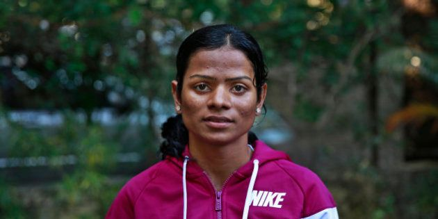 In this Wednesday, Oct. 29, 2014 photo, Indian athlete Dutee Chand poses for the camera in Mumbai, India....
