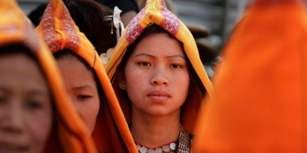 A tribal girl looks on during Arunachal Pradesh statehood day celebrations in Itanagar, Arunachal Pradesh,...