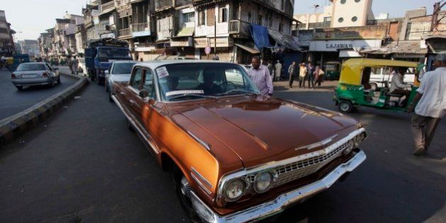 An Indian man drives his vintage Chevrolet during a vintage car rally in Ahmadabad, India, Sunday, Nov....
