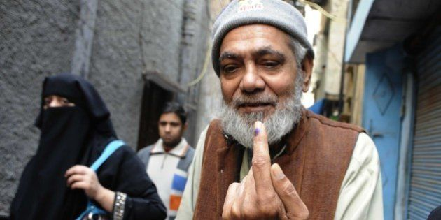 NEW DELHI, INDIA - FEBRUARY 7: An Indian Muslim man showing inked finger after casting vote at nearest...