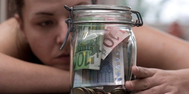GERMANY, BONN - JANUARY 16:You can save on different art. Saved money in a preserving jar, on January...