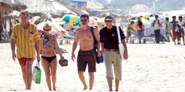 In this Dec. 16, 2008 photo, tourists walk on the beach in Goa, India. With the country on alert in the...