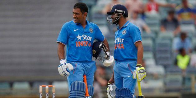 India's MS Dhoni, left, and team mate Ravindra Jadeja speak during their one-day international cricket...