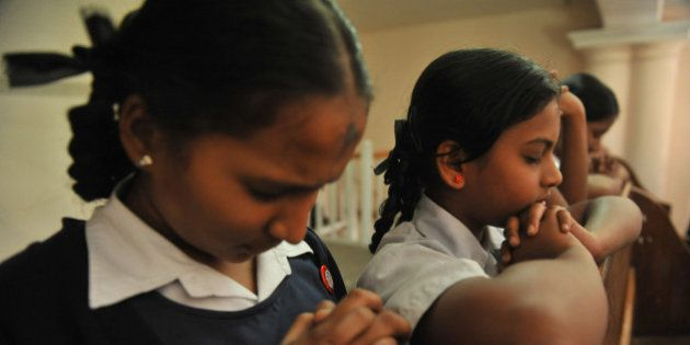 An Indian Catholic students offer prayers during an Ash Wednesday service at Saint Mary's Church in Secunderabad,the...