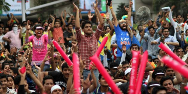 NEW DELHI, INDIA - MARCH 26: Indian fans enjoying India vs Australia Cricket World cup semifinal match...