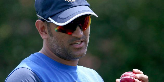 FILE - In this Jan. 4, 2015 file photo, India's Mahendra Singh Dhoni prepares to bowl in the nets as...