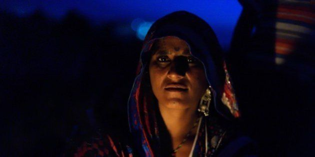 In this photograph taken on March 24, 2015, Indian nomadic shepherd Dukki poses at her camp at Sikri...