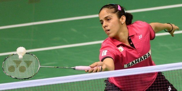 In this photograph taken on March 25, 2015, Saina Nehwal of India plays a shot during her women's badminton...
