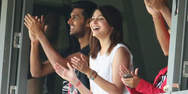 MELBOURNE, AUSTRALIA - DECEMBER 28: Anushka Sharma, girlfriend of Virat Kohli smiles as Kohli celebrates...