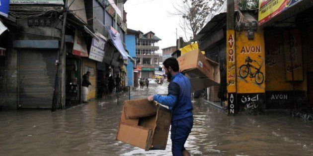 SRINAGAR, INDIA - MARCH 29: Shopkeepers shift merchandise to safer places in wake of accumulation of...