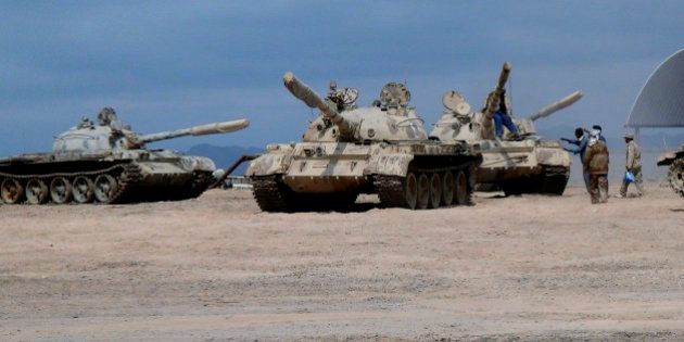 In this photo taken Tuesday, March 24, 2015, tanks seized recently by militiamen loyal to Yemen's President...