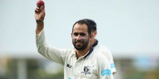 HOBART, AUSTRALIA - MARCH 22: Fawad Ahmed of Victoria walks off holding the ball up high after taking...