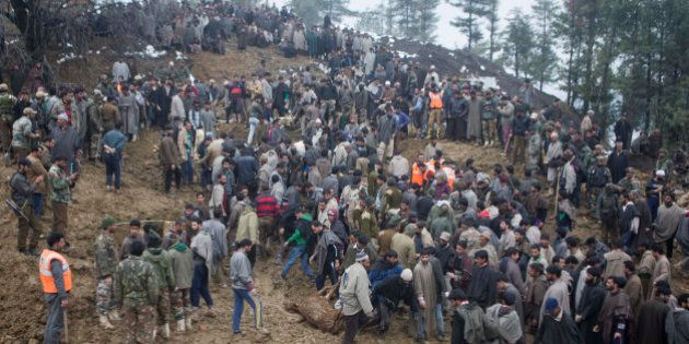 Kashmiri villagers and officials search for bodies of victims following landslides due to heavy rainfall...