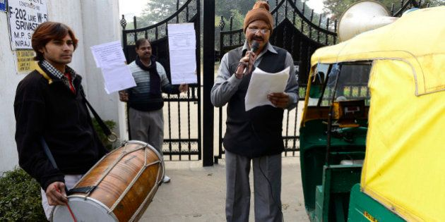 NEW DELHI, INDIA - JANUARY 02: MCD drum beaters outside the home of a tax defaulter in Sainik Farms on...