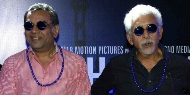 Indian Bollywood actors (L/R) Paresh Rawal and Nasseruddin Shah look on during the trailer launch of...