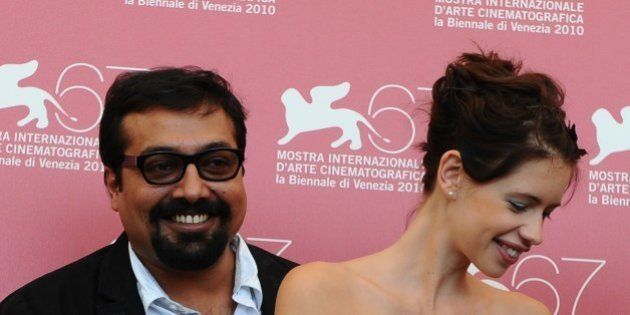 Indian film director Anurag Kashyap (L) and actress Kalki Koechlin pose during the photocall of 'That...
