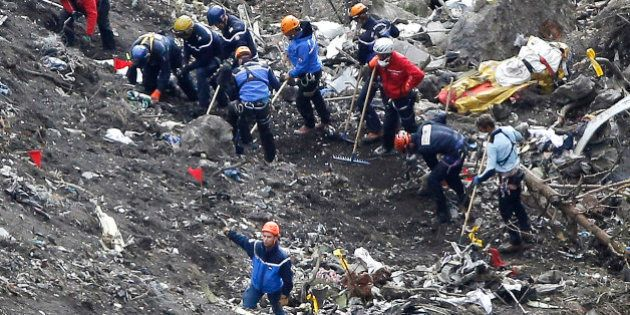 FILE - In this Thursday March 26, 2015 file photo, rescue workers inspect the debris from the Germanwings...