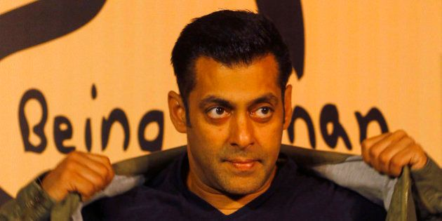Bollywood star Salman Khan poses wearing a Being Human t-shirt during the launch of Being Human's first flagship store in Mumbai, India, Thursday, Jan. 17, 2013. Being Human is a charitable trust that helps spread education and healthcare for underprivileged children. (AP Photo/Rafiq Maqbool)