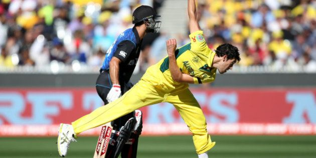 Australia's Mitchell Starc bowls during the Cricket World Cup final against New Zealand in Melbourne,...