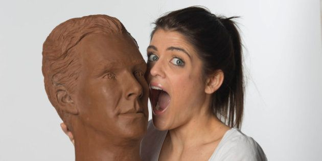 Clodagh Pickavance, 23, interacts with a life-size chocolate sculpture of actor Benedict Cumberbatch....