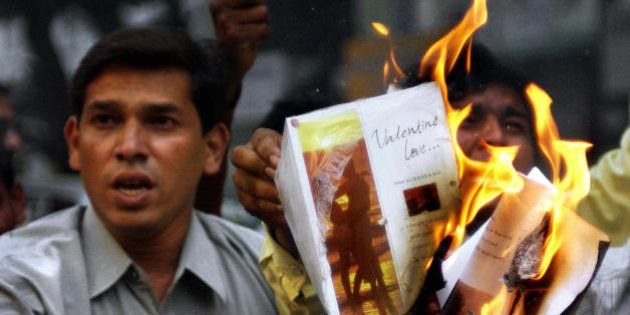 BOMBAY, INDIA: Activists of hardline Hindu party, Shiv Sena, burn greeting cards in protest against Valentine's...