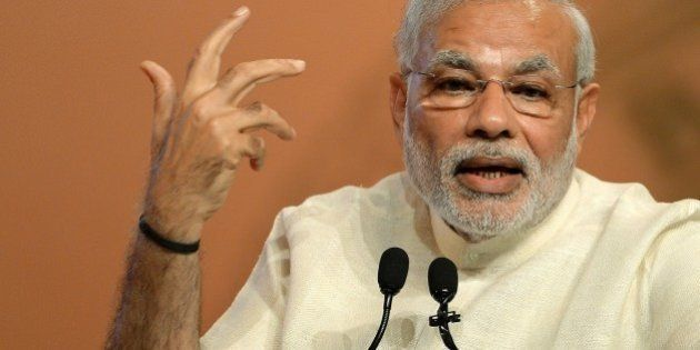 Indian Prime Minister Narendra Modi gestures as he speaks during the inauguration of a conference on...