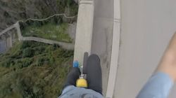 Watch This Insane Unicyclist Defy His Fear Of Heights...With Zero Safety