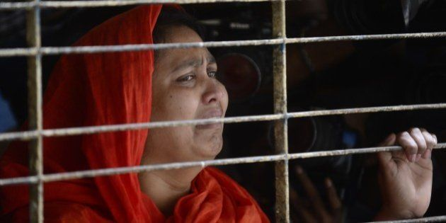 A relative of dead Bangladeshi blogger Washiqur Rahman reacts after seeing his body at Dhaka Medical...