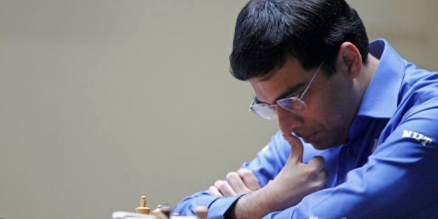 World Chess champion Viswanathan Anand from India, contemplates his next move during a match against...