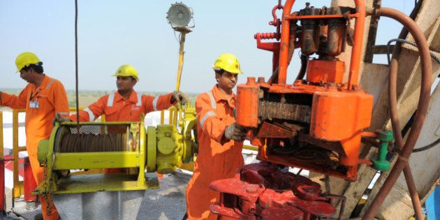 Indian technicians work on the country's first shale-gas exploratory well at ONGC Ankleshwar Asset near...