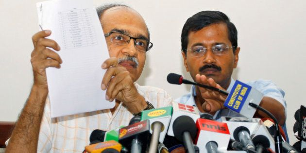 Prashant Bhushan, left, and Arvind Kejriwal, associates of Anna Hazare, India's most prominent anti-corruption...