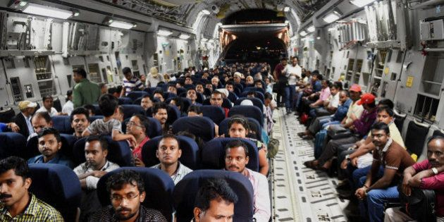 Indians evacuated from Yemen sit inside the Indian Air Force C17 Globemaster aircraft upon their arrival...
