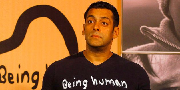 Bollywood star Salman Khan poses wearing a Being Human t-shirt during the launch of Being Human's first...