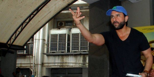 Indian Bollywood actor Saif Ali Khan throws material into the crowd during the promotion of their Hindi...