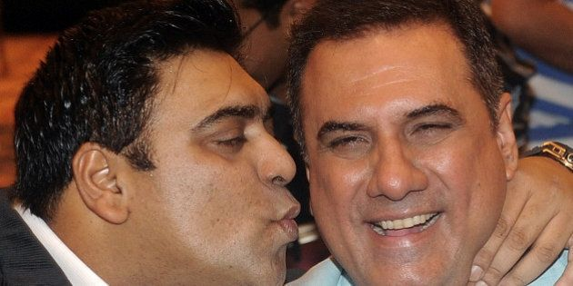 Indian Bollywood actor Ram Kapoor (L) joke with co-actor Boman Irani during the press conference of their...