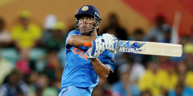 India's MS Dhoni plays a shot while batting against Australia during their Cricket World Cup semifinal...