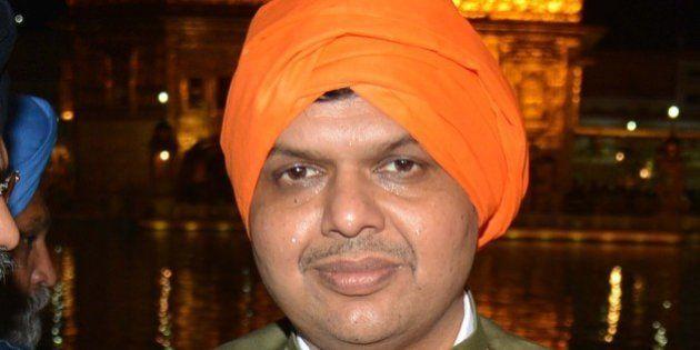 Chief Minister for Maharashtra state Devendra Fadnavis (C) visits the Sikh Shrine Golden temple in Amritsar...