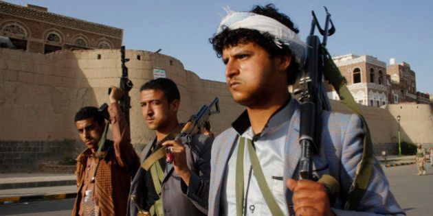 FILE - In this Wednesday, April 1, 2015 file photo, Shiite rebels, known as Houthis, carry their weapons...