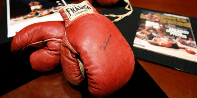 The boxing gloves of Muhammad Ali, front, and of Sonny Liston, rear, sit on a table at Heritage Auctions...