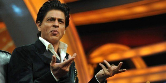 Indian Bollywood actor Shah Rukh Khan gestures during a press interaction to launch a new television...