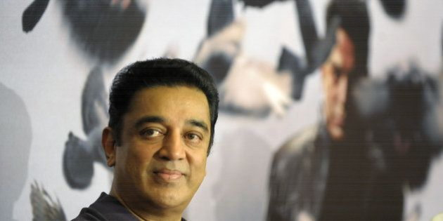 Indian film actor, producer and director Kamal Haasan gestures at a press conference in Hyderabad on...