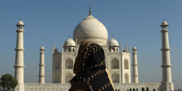 AGRA, INDIA - SEPTEMBER 29: A woman looks at the Taj Mahal on September 29, 2010 in Agra, India. Completed...
