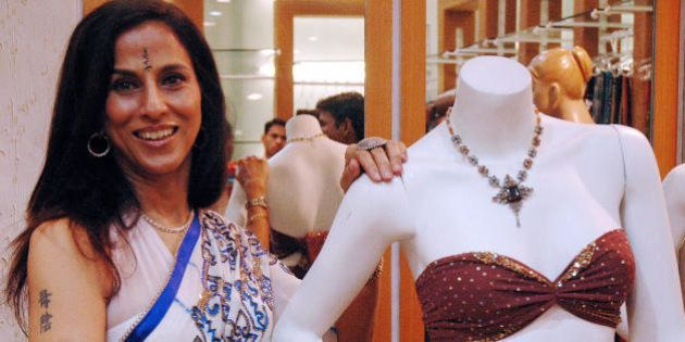 Indian writer and columnist Shobhaa De poses with newly-launched 'Cocktail Sarees' she designed during...