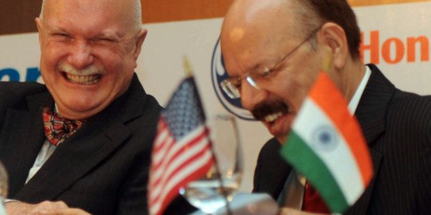 Director General of Indian Civil Aviation, Nasim Zaidi (R) talks with the US Ambassador to India, Peter...