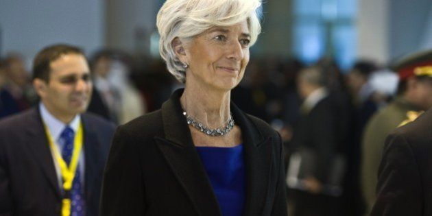 The Managing Director of the International Monetary Fund (IMF) Christine Lagarde (C) arrives for the...