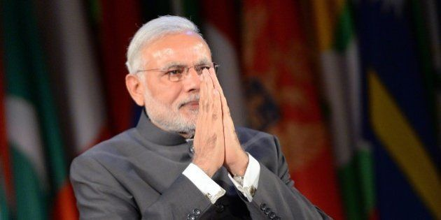 Indian Prime Minister Narendra Modi acknowledges the audience after delivering a speech on April 10,...